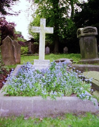 lewis Carroll's grave overgrown with forget-me-nots